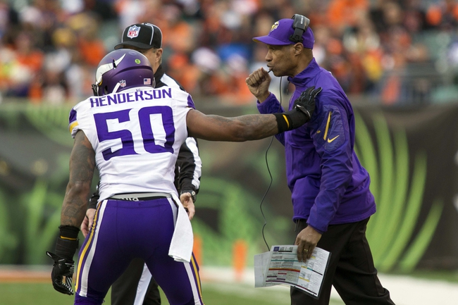 Dec 22, 2013; Cincinnati, OH, USA;  Minnesota Vikings head coach Leslie Frazier gives Minnesota Vikings middle linebacker Erin Henderson (50) a defensive play in the fourth quarter of the game at Paul Brown Stadium. Cincinnati Bengals beat the Minnesota Vikings by the score of 42-14. Mandatory Credit: Trevor Ruszkowksi-USA TODAY Sports