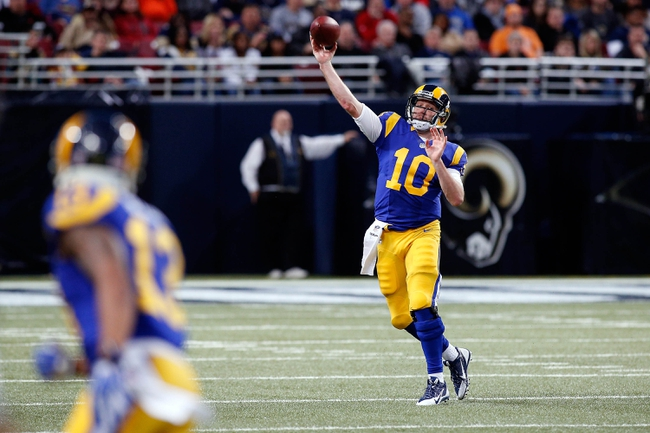Dec 22, 2013; St. Louis, MO, USA; St. Louis Rams quarterback Kellen Clemens (10) throws a pass to wide receiver Chris Givens (13) during the second half against the Tampa Bay Buccaneers at the Edward Jones Dome. Mandatory Credit: Scott Kane-USA TODAY Sports