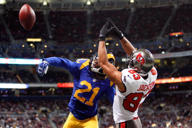 Dec 22, 2013; St. Louis, MO, USA; St. Louis Rams cornerback Janoris Jenkins (21) deflects the ball from Tampa Bay Buccaneers tight end Tom Crabtree (84) in the end zone during the second half at the Edward Jones Dome. Mandatory Credit: Scott Kane-USA TODAY Sports