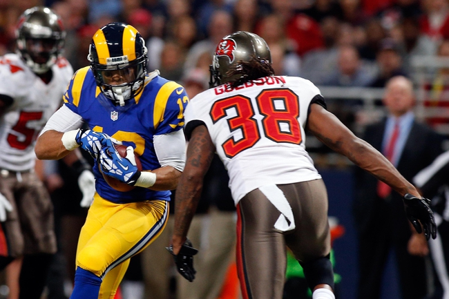 Dec 22, 2013; St. Louis, MO, USA; St. Louis Rams wide receiver Stedman Bailey (12) carries the ball as Tampa Bay Buccaneers free safety Dashon Goldson (38) looks for the tackle during the second half at the Edward Jones Dome. Mandatory Credit: Scott Kane-USA TODAY Sports