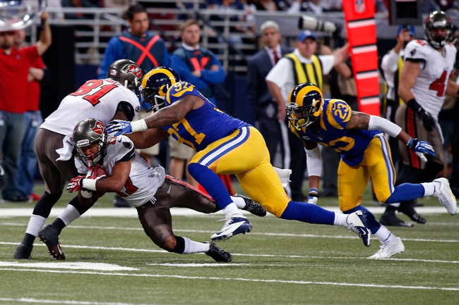 Dec 22, 2013; St. Louis, MO, USA; St. Louis Rams defensive end Eugene Sims (97) tackles Tampa Bay Buccaneers wide receiver Eric Page (17) during the second half at the Edward Jones Dome. Mandatory Credit: Scott Kane-USA TODAY Sports