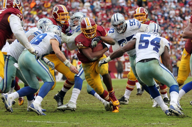 Dec 22, 2013; Landover, MD, USA; Washington Redskins running back Alfred Morris (46) carries the ball as Dallas Cowboys outside linebacker Bruce Carter (54) attempts to tackle in the third quarter at FedEx Field. The Cowboys won 24-23. Mandatory Credit: Geoff Burke-USA TODAY Sports