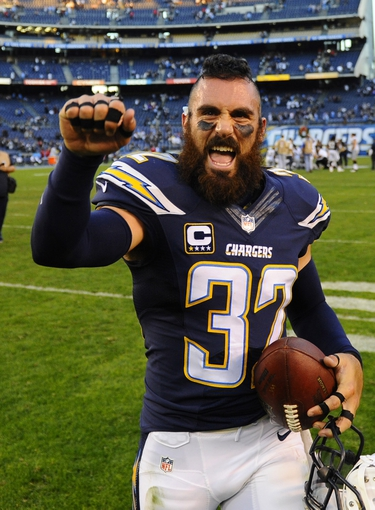 Dec 22, 2013; San Diego, CA, USA; San Diego Chargers safety Eric Weddle (32) celebrates after a win against the Oakland Raiders at Qualcomm Stadium. The Chargers won 26-13. Mandatory Credit: Christopher Hanewinckel-USA TODAY Sports