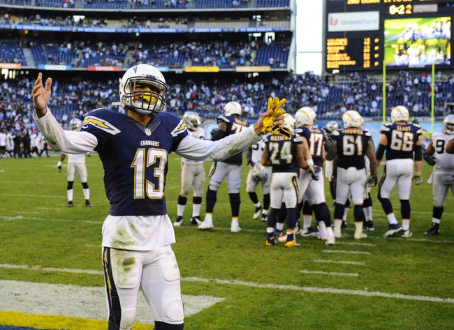 Dec 22, 2013; San Diego, CA, USA; San Diego Chargers receiver Keenan Allen (13) celebrates after a win against the Oakland Raiders at Qualcomm Stadium. The Chargers won 26-13. Mandatory Credit: Christopher Hanewinckel-USA TODAY Sports