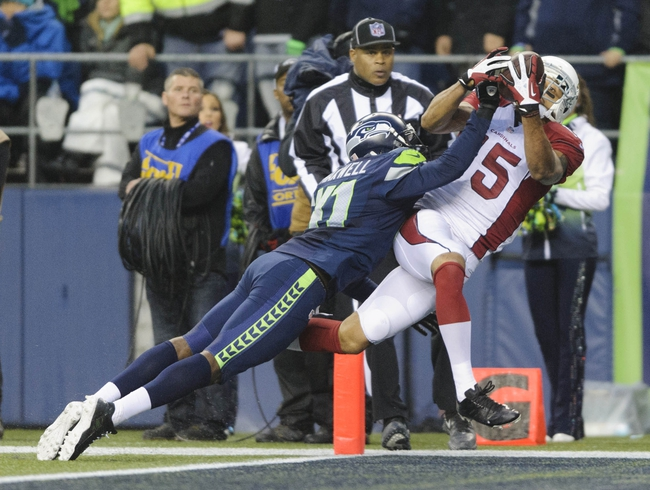 Dec 22, 2013; Seattle, WA, USA; Arizona Cardinals wide receiver Michael Floyd (15) catches a pass for a touchdown over Seattle Seahawks cornerback Byron Maxwell (41) during the second half at CenturyLink Field. Arizona defeated Seattle 17-10. Mandatory Credit: Steven Bisig-USA TODAY Sports