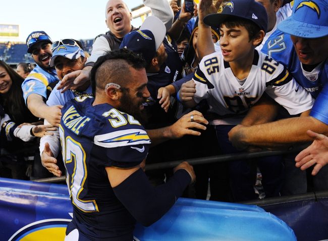 Dec 22, 2013; San Diego, CA, USA; San Diego Chargers safety Eric Weddle (32) celebrates with fans after a win against the Oakland Raiders at Qualcomm Stadium. The Chargers won 26-13. Mandatory Credit: Christopher Hanewinckel-USA TODAY Sports