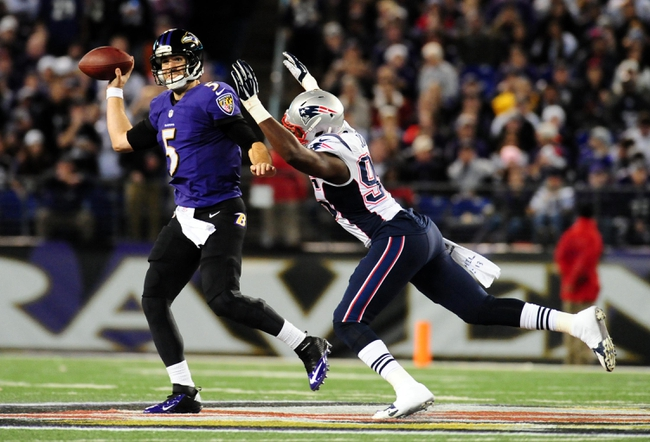 Dec 22, 2013; Baltimore, MD, USA; Baltimore Ravens quarterback Joe Flacco (5) throws the ball while being pressured by New England Patriots defensive end Chandler Jones (95) at M&T Bank Stadium. Mandatory Credit: Evan Habeeb-USA TODAY Sports
