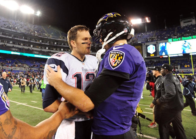 Dec 22, 2013; Baltimore, MD, USA; New England Patriots quarterback Tom Brady (12) shakes hands with Baltimore Ravens quarterback Joe Flacco (5) after beating the Ravens 41-7 at M&T Bank Stadium. Mandatory Credit: Evan Habeeb-USA TODAY Sports