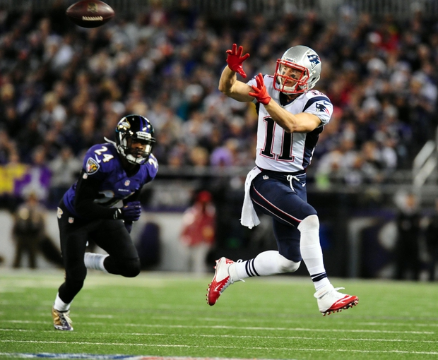 Dec 22, 2013; Baltimore, MD, USA; New England Patriots wide receiver Julian Edelman (11) catches a pass in front of Baltimore Ravens cornerback Corey Graham (24) at M&T Bank Stadium. Mandatory Credit: Evan Habeeb-USA TODAY Sports