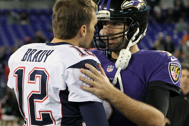 Dec 22, 2013; Baltimore, MD, USA; New England Patriots quarterback Tom Brady (12) greets Baltimore Ravens quarterback Joe Flacco (5) after the game at M&T Bank Stadium. Mandatory Credit: Mitch Stringer-USA TODAY Sports