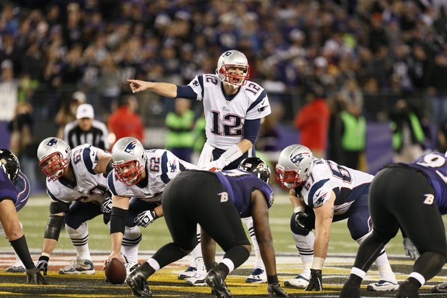 Dec 22, 2013; Baltimore, MD, USA; New England Patriots quarterback Tom Brady (12) directs the offense against the Baltimore Ravens at M&T Bank Stadium. Mandatory Credit: Mitch Stringer-USA TODAY Sports