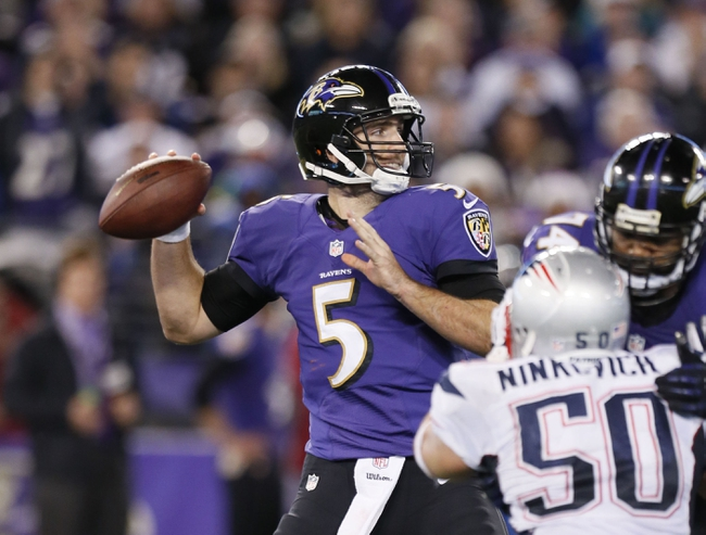 Dec 22, 2013; Baltimore, MD, USA; Baltimore Ravens quarterback Joe Flacco (5) pressured by the New England Patriots defense at M&T Bank Stadium. Mandatory Credit: Mitch Stringer-USA TODAY Sports