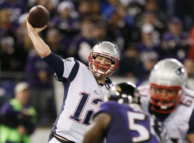 Dec 22, 2013; Baltimore, MD, USA; New England Patriots quarterback Tom Brady (12) passes against the Baltimore Ravens at M&T Bank Stadium. Mandatory Credit: Mitch Stringer-USA TODAY Sports