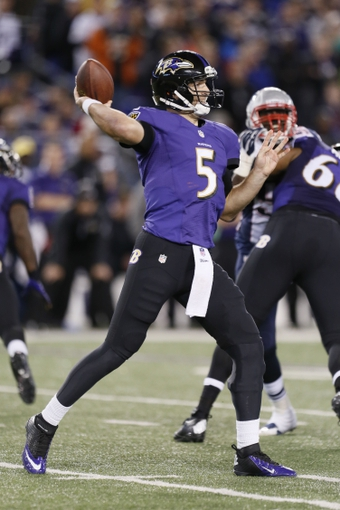 Dec 22, 2013; Baltimore, MD, USA; Baltimore Ravens quarterback Joe Flacco (5) passes against the New England Patriots defense at M&T Bank Stadium. Mandatory Credit: Mitch Stringer-USA TODAY Sports