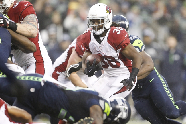 Dec 22, 2013; Seattle, WA, USA; Arizona Cardinals running back Andre Ellington (38) rushes against the Seattle Seahawks during the fourth quarter at CenturyLink Field. Mandatory Credit: Joe Nicholson-USA TODAY Sports