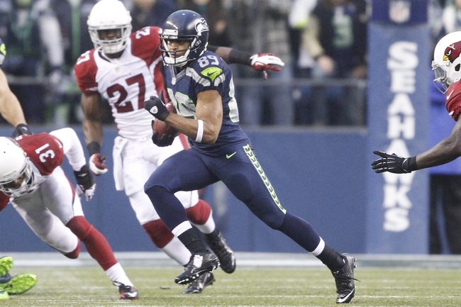 Dec 22, 2013; Seattle, WA, USA; Seattle Seahawks wide receiver Doug Baldwin (89) returns a kick against the Arizona Cardinals during the fourth quarter at CenturyLink Field. Mandatory Credit: Joe Nicholson-USA TODAY Sports
