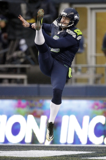 Dec 22, 2013; Seattle, WA, USA; Seattle Seahawks punter Jon Ryan (9) kicks a punt against the Arizona Cardinals during the third quarter at CenturyLink Field. Mandatory Credit: Joe Nicholson-USA TODAY Sports