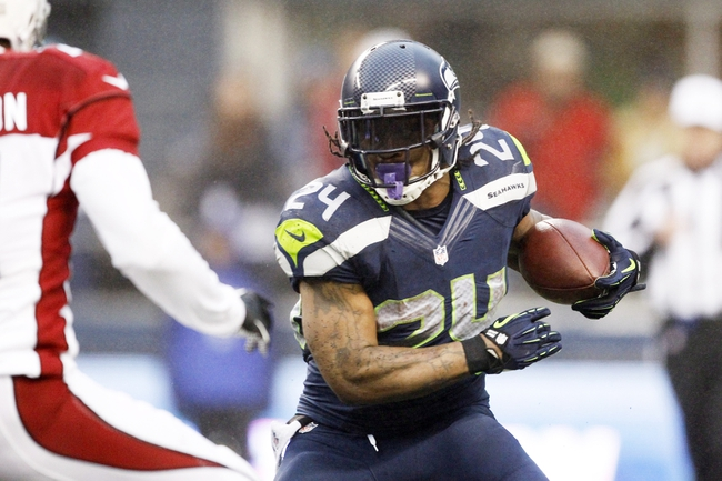 Dec 22, 2013; Seattle, WA, USA; Seattle Seahawks running back Marshawn Lynch (24) rushes against the Arizona Cardinals during the third quarter at CenturyLink Field. Mandatory Credit: Joe Nicholson-USA TODAY Sports