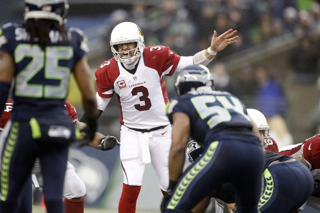 Dec 22, 2013; Seattle, WA, USA; Arizona Cardinals quarterback Carson Palmer (3) yells against the Seattle Seahawks during the third quarter at CenturyLink Field. Mandatory Credit: Joe Nicholson-USA TODAY Sports
