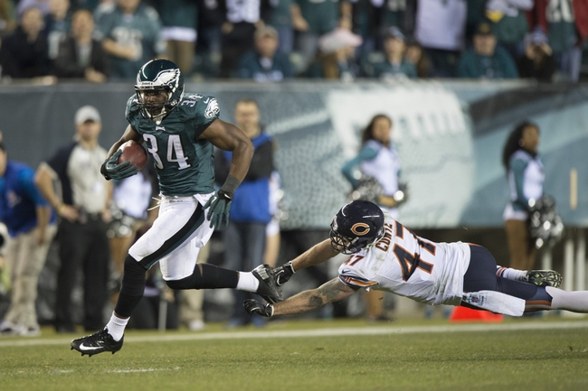 Dec 22, 2013; Philadelphia, PA, USA; Philadelphia Eagles running back Bryce Brown (34) runs with the ball past a diving Chicago Bears free safety Chris Conte (47)  for a touchdown during the fourth quarter  at Lincoln Financial Field. Philadelphia Eagles defeated the Chicago Bears 54-11. Mandatory Credit: Tommy Gilligan-USA TODAY Sports