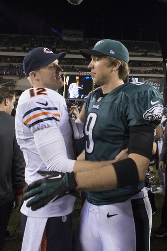 Dec 22, 2013; Philadelphia, PA, USA; Chicago Bears quarterback Josh McCown (12) and Philadelphia Eagles quarterback Nick Foles (9) speak after the game  at Lincoln Financial Field. Philadelphia Eagles defeated the Chicago Bears 54-11. Mandatory Credit: Tommy Gilligan-USA TODAY Sports