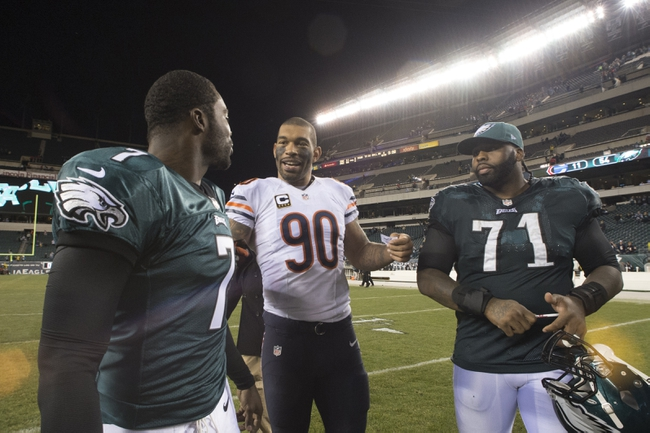 Dec 22, 2013; Philadelphia, PA, USA; Chicago Bears defensive end Julius Peppers (90) speaks with Philadelphia Eagles quarterback Michael Vick (7) and  tackle Jason Peters (71) after the game at Lincoln Financial Field. Philadelphia Eagles defeated the Chicago Bears 54-11. Mandatory Credit: Tommy Gilligan-USA TODAY Sports