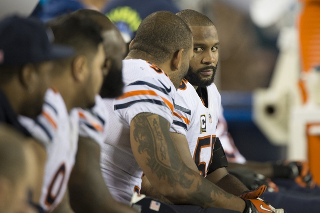 Dec 22, 2013; Philadelphia, PA, USA; Chicago Bears outside linebacker Lance Briggs (55) and defensive end Julius Peppers (90) speak on the bench during the fourth quarter  at Lincoln Financial Field. Philadelphia Eagles defeated the Chicago Bears 54-11. Mandatory Credit: Tommy Gilligan-USA TODAY Sports