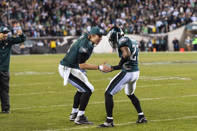 Dec 22, 2013; Philadelphia, PA, USA; Philadelphia Eagles cornerback Brandon Boykin (22) celebrates scoring a touchdown with quarterback Nick Foles (9) during the fourth quarter against the Chicago Bears at Lincoln Financial Field. The Eagles defeated the Bears 54-11. Mandatory Credit: Howard Smith-USA TODAY Sports