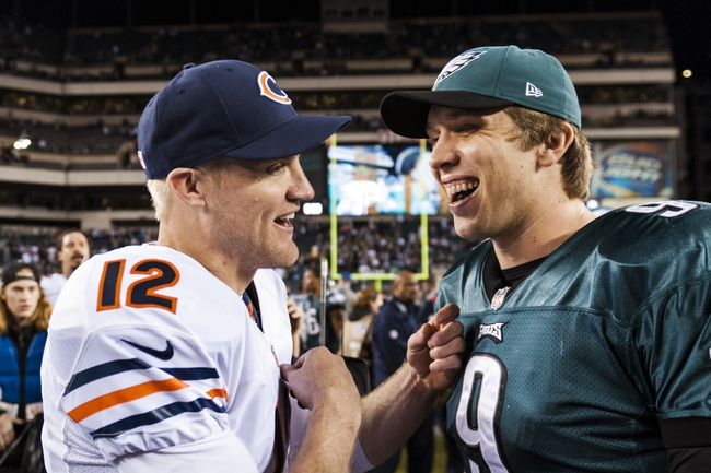 Dec 22, 2013; Philadelphia, PA, USA; Philadelphia Eagles quarterback Nick Foles (9) talks with Chicago Bears quarterback Josh McCown (12) after the game at Lincoln Financial Field. The Eagles defeated the Bears 54-11. Mandatory Credit: Howard Smith-USA TODAY Sports