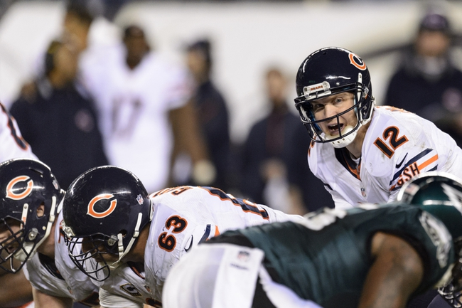 Dec 22, 2013; Philadelphia, PA, USA; Chicago Bears quarterback Josh McCown (12) under center during the fourth quarter against the Philadelphia Eagles at Lincoln Financial Field. The Eagles defeated the Bears 54-11. Mandatory Credit: Howard Smith-USA TODAY Sports