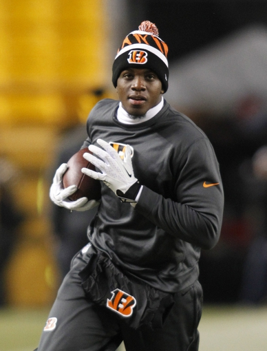 Dec 15, 2013; Pittsburgh, PA, USA; Cincinnati Bengals wide receiver A.J. Green (18) warms-up on the field before playing the Pittsburgh Steelers at Heinz Field. The Steelers won 30-20. Mandatory Credit: Charles LeClaire-USA TODAY Sports