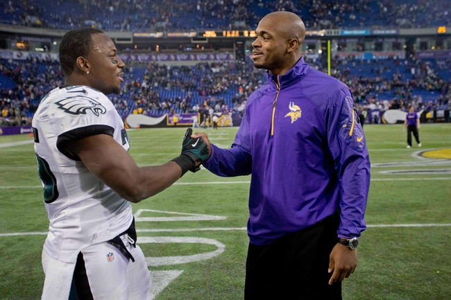 Dec 15, 2013; Minneapolis, MN, USA; Philadelphia Eagles running back LeSean McCoy (25) meets with Minnesota Vikings running back Adrian Peterson (28) after the game at Mall of America Field at H.H.H. Metrodome. The Vikings win 48-30. Mandatory Credit: Bruce Kluckhohn-USA TODAY Sports