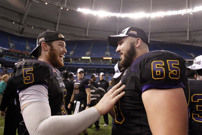 Dec 23, 2013; St. Petersburg, FL, USA; East Carolina Pirates quarterback Shane Carden (5) smiles with offensive linesman J.T. Boyd (65) after they beat the Ohio Bobcats at the 2013 Beef O Bradys Bowl at Tropicana Field. East Carolina won 37-20. Mandatory Credit: Kim Klement-USA TODAY Sports