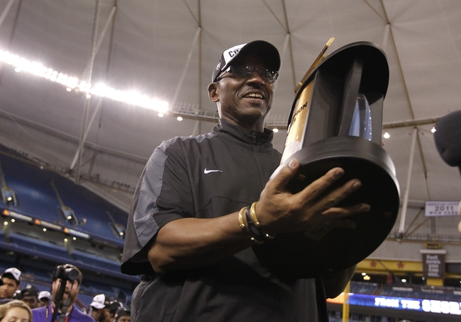 Dec 23, 2013; St. Petersburg, FL, USA; East Carolina Pirates head coach Ruffin McNeill holds the trophy after they beat the Ohio Bobcats at the 2013 Beef O Bradys Bowl at Tropicana Field. Eastern Carolina Pirates defeated the Ohio Bobcats 37-20. Mandatory Credit: Kim Klement-USA TODAY Sports