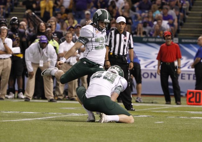 Dec 23, 2013; St. Petersburg, FL, USA; Ohio Bobcats kicker Josiah Yazdani (39) kicks a field goal against the East Carolina Pirates during the second half at the 2013 Beef O Bradys Bowl at Tropicana Field. Eastern Carolina Pirates defeated the Ohio Bobcats 37-20. Mandatory Credit: Kim Klement-USA TODAY Sports