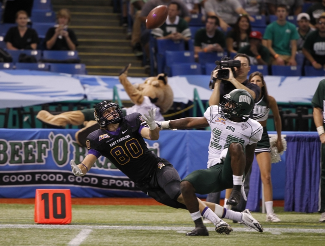 Dec 23, 2013; St. Petersburg, FL, USA; Ohio Bobcats cornerback Travis Carrie (18) gets called for pass interference on East Carolina Pirates wide receiver Bryce Williams (80) during the second half at the 2013 Beef O Bradys Bowl at Tropicana Field. Eastern Carolina Pirates defeated the Ohio Bobcats 37-20. Mandatory Credit: Kim Klement-USA TODAY Sports