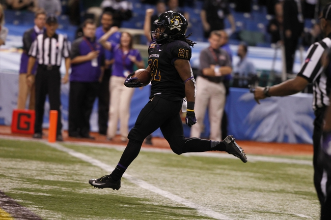 Dec 23, 2013; St. Petersburg, FL, USA; East Carolina Pirates running back Vintavious Cooper (21) runs the ball in for a touchdown against the Ohio Bobcats during the second half at the 2013 Beef O Bradys Bowl at Tropicana Field. Eastern Carolina Pirates defeated the Ohio Bobcats 37-20. Mandatory Credit: Kim Klement-USA TODAY Sports