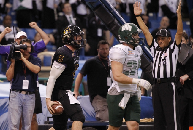 Dec 23, 2013; St. Petersburg, FL, USA; East Carolina Pirates quarterback Shane Carden (5) reacts after the caught the ball for a touchdown against the Ohio Bobcats during the second half at the 2013 Beef O Bradys Bowl at Tropicana Field. Eastern Carolina Pirates defeated the Ohio Bobcats 37-20. Mandatory Credit: Kim Klement-USA TODAY Sports
