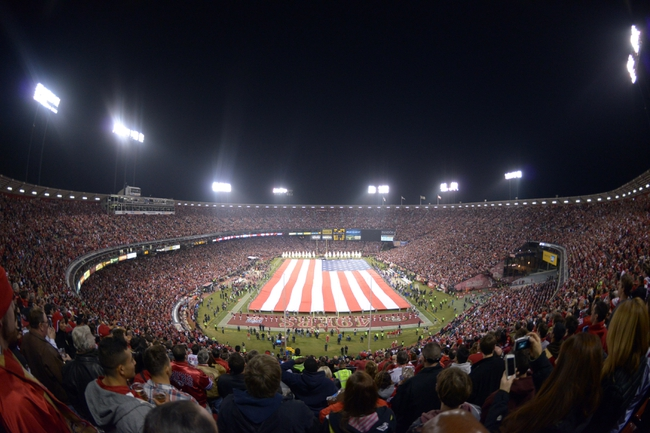 Dec 23, 2013; San Francisco, CA, USA; General view of the playing of the national anthem with a United States flag on the field before the final regular season game at Candlestick Park between the Atlanta Falcons and the San Francisco 49ers. Mandatory Credit: Kirby Lee-USA TODAY Sports