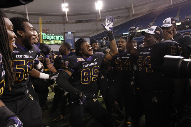 Dec 23, 2013; St. Petersburg, FL, USA; East Carolina Pirates wide receiver Brandon Bishop (89) and teammates celebrate after they beat the Ohio Bobcats during the second half at the 2013 Beef O Bradys Bowl at Tropicana Field. Eastern Carolina Pirates defeated the Ohio Bobcats 37-20. Mandatory Credit: Kim Klement-USA TODAY Sports
