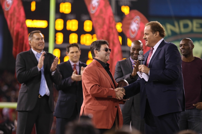 Dec 23, 2013; San Francisco, CA, USA; American sportscaster Chris Berman (right) shakes hands with former San Francisco 49ers owner Eddie DeBartolo Jr. (left) after the final regular season game against the Atlanta Falcons at Candlestick Park. The San Francisco 49ers defeated the Atlanta Falcons 34-24. Mandatory Credit: Kelley L Cox-USA TODAY Sports