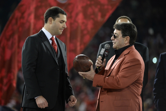 December 23, 2013; San Francisco, CA, USA; San Francisco 49ers former owner Eddie DeBartolo Jr. (right) hands the game ball to chief executive officer Jed York (left) after the final regular season game against the Atlanta Falcons at Candlestick Park. The 49ers defeated the Falcons 34-24. Mandatory Credit: Kyle Terada-USA TODAY Sports