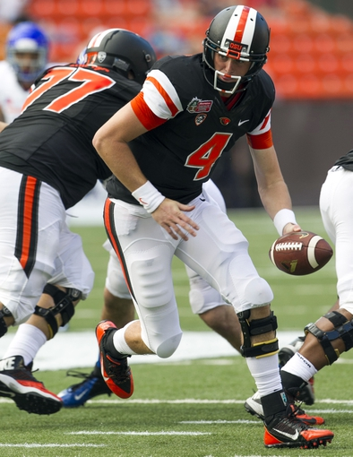 Dec 24, 2013; Honolulu, HI, USA; Oregon State Beavers quarterback Sean Mannion (4) makes a hand off during the 2nd quarter of the 2013 Hawaii Bowl against Boise State Broncos at Aloha Stadium. Mandatory Credit: Marco Garcia-USA TODAY Sports
