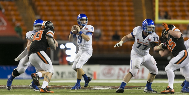 Dec 24, 2013; Honolulu, HI, USA; Boise State Broncos quarterback Grant Hedrick (9) looks for an open receiver against the Oregon State Beavers in the fourth quarter at the 2013 Hawaii Bowl at Aloha Stadium. Mandatory Credit: Marco Garcia-USA TODAY Sports