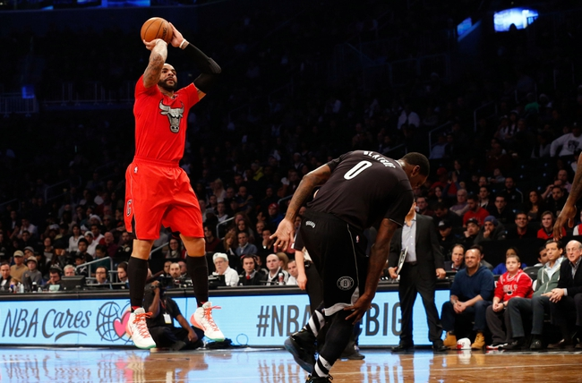 Dec 25, 2013; Brooklyn, NY, USA;  Chicago Bulls power forward Carlos Boozer (5) shoots during the first quarter against the Brooklyn Nets at Barclays Center. Mandatory Credit: Anthony Gruppuso-USA TODAY Sports