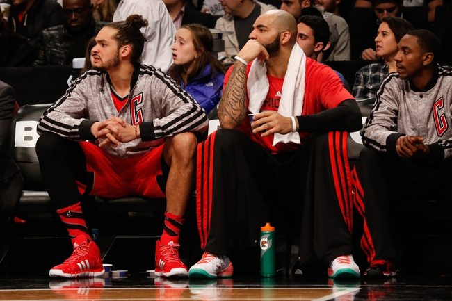 Dec 25, 2013; Brooklyn, NY, USA;  Chicago Bulls center Joakim Noah (13) and power forward Carlos Boozer (5) on the bench during the second quarter against the Brooklyn Nets at Barclays Center. Mandatory Credit: Anthony Gruppuso-USA TODAY Sports