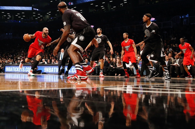 Dec 25, 2013; Brooklyn, NY, USA; Chicago Bulls power forward Carlos Boozer (5) drives to the net during the first quarter against the Brooklyn Nets at Barclays Center. Mandatory Credit: Anthony Gruppuso-USA TODAY Sports