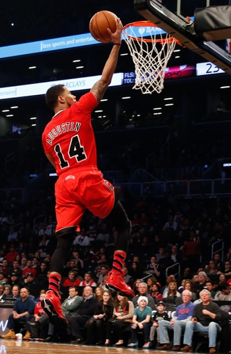 Dec 25, 2013; Brooklyn, NY, USA;  Chicago Bulls point guard D.J. Augustin (14) shoots during the second quarter against the Brooklyn Nets at Barclays Center. Mandatory Credit: Anthony Gruppuso-USA TODAY Sports