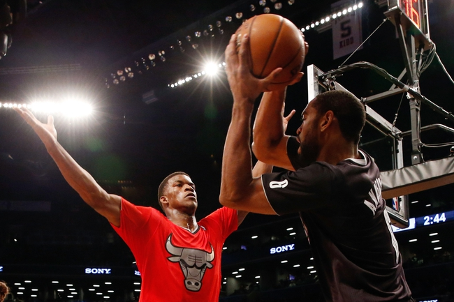 Dec 25, 2013; Brooklyn, NY, USA;   Chicago Bulls shooting guard Jimmy Butler (21) guards Brooklyn Nets shooting guard Alan Anderson (6) during the fourth quarter at Barclays Center. Chicago Bulls won 95-78.  Mandatory Credit: Anthony Gruppuso-USA TODAY Sports