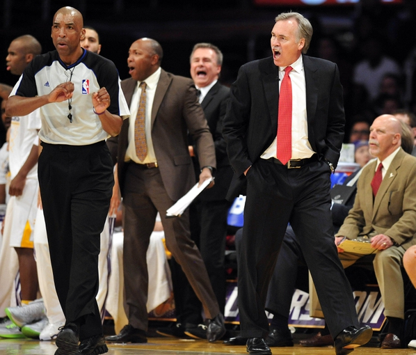 December 25, 2013; Los Angeles, CA, USA; Los Angeles Lakers head coach Mike D'Antoni reacts to a call by official Leon Wood against the Lakers during the second half at Staples Center. Mandatory Credit: Gary A. Vasquez-USA TODAY Sports